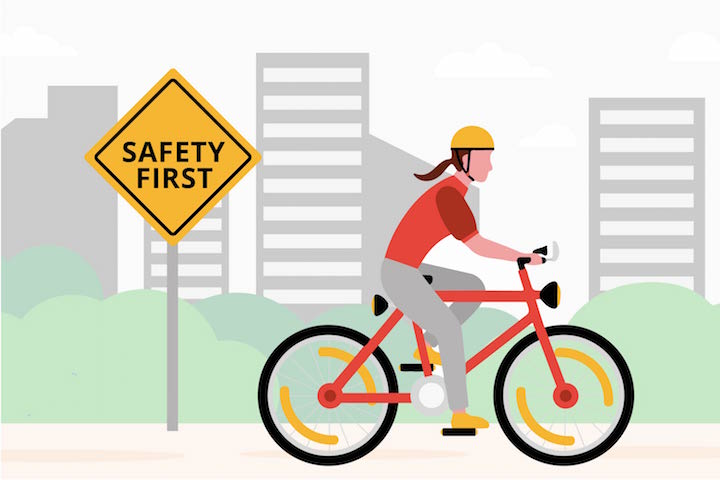 cycling on the road with safety first sign