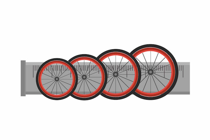 different bike tires with a giant ruler
